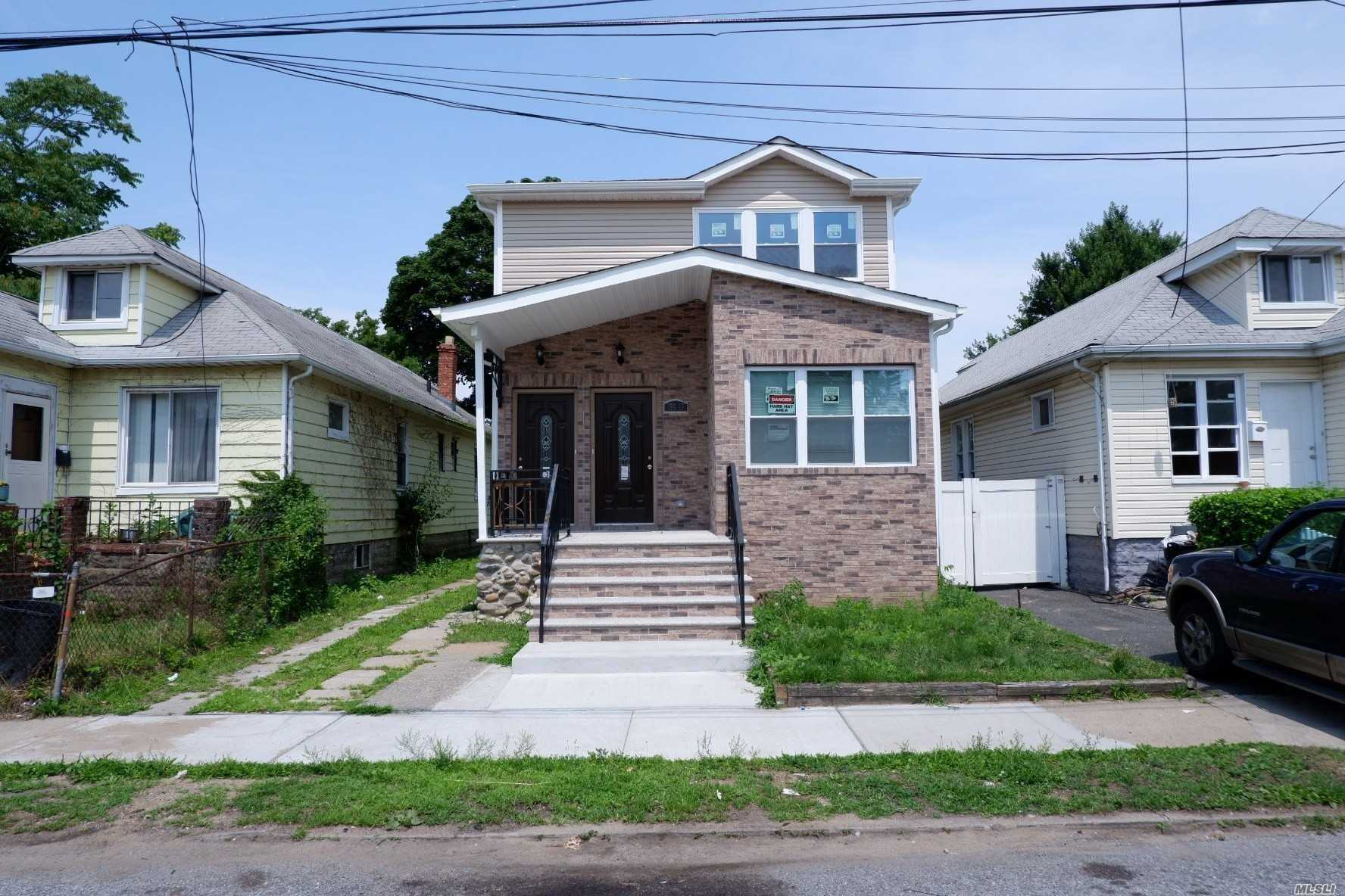 Photo of home for sale at 168-15 119th Ave, Jamaica NY