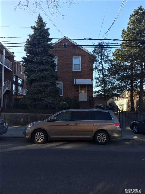 Photo of home for sale at 50-14 104th St, Corona NY