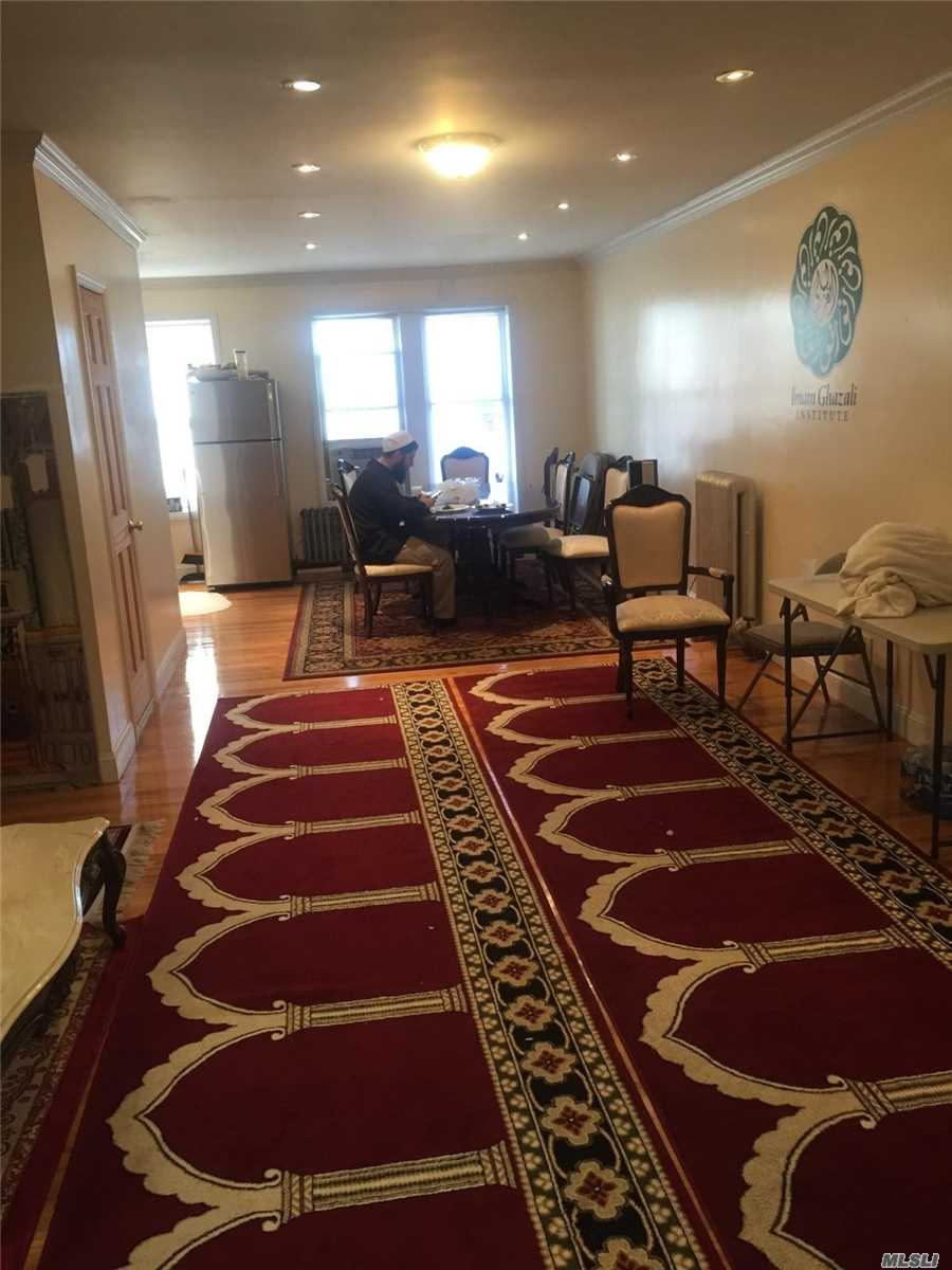 Photo of home for sale at 106-08 Liberty Ave, Ozone Park NY
