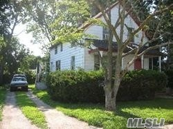 Photo of home for sale at 209 Costar St, Westbury NY
