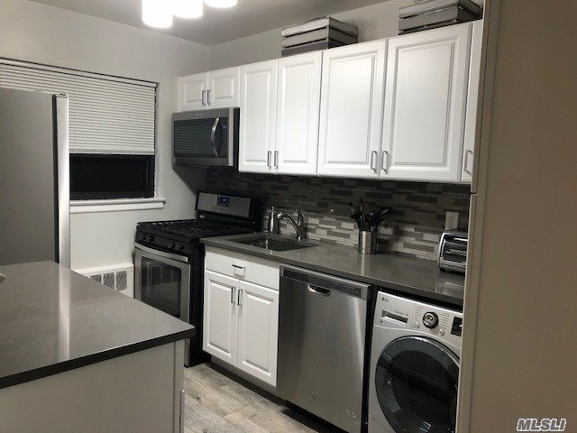 Photo of home for sale at 219-15 74th Ave, Bayside NY