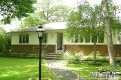 Photo of home for sale at 18 Oakwood Rd, Hampton Bays NY