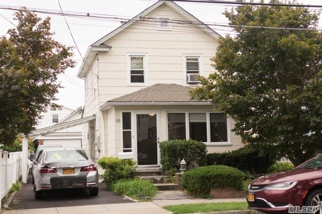 Photo of home for sale at 88 Pine St, Oceanside NY