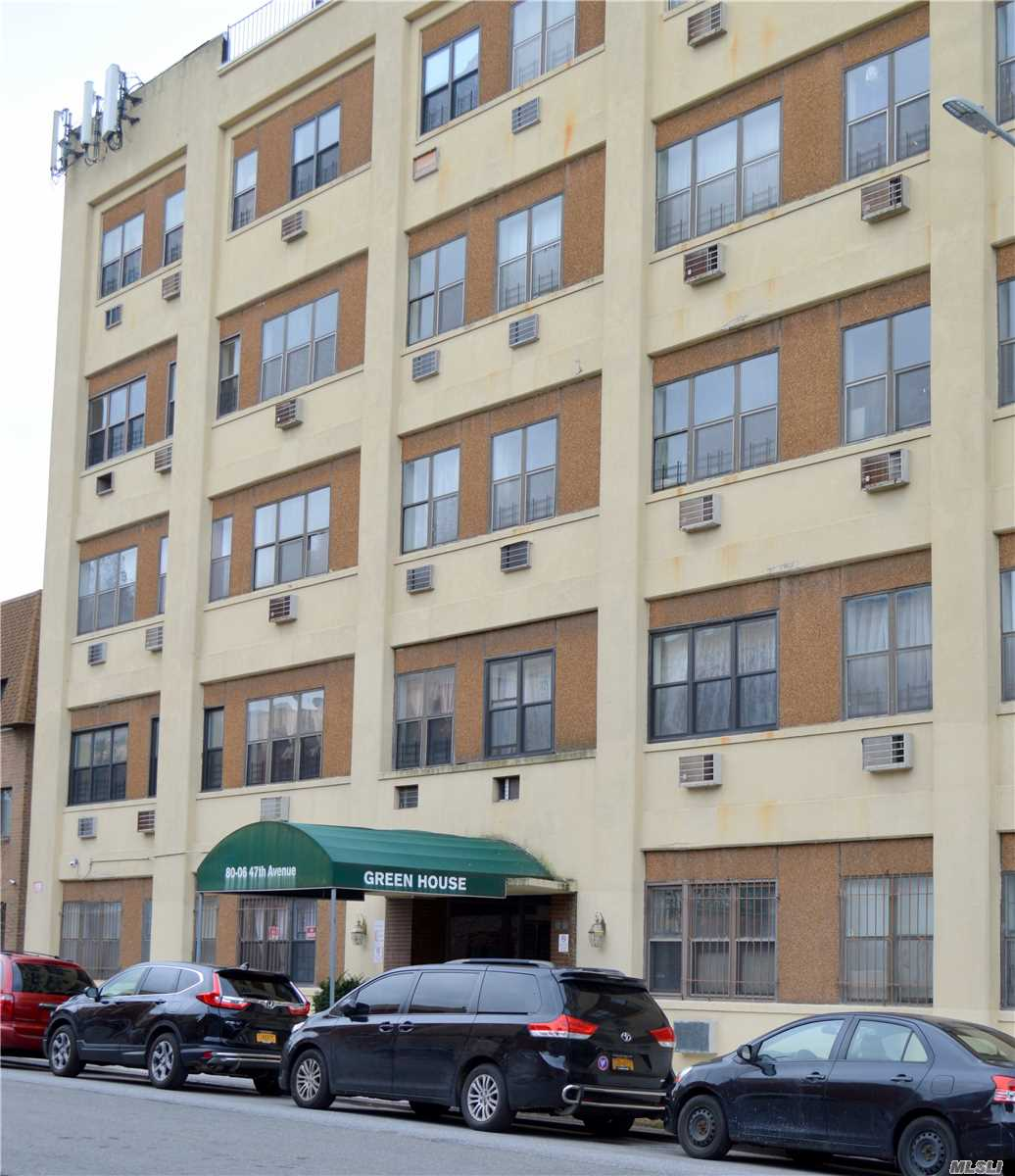 Photo of home for sale at 80-06 47th Ave, Elmhurst NY