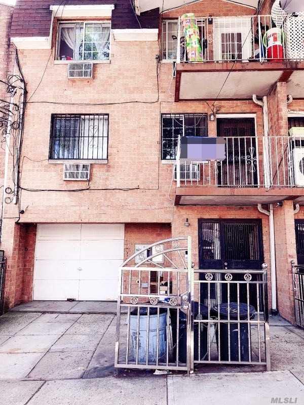 Photo of home for sale at 57-44 Van Doren St, Corona NY