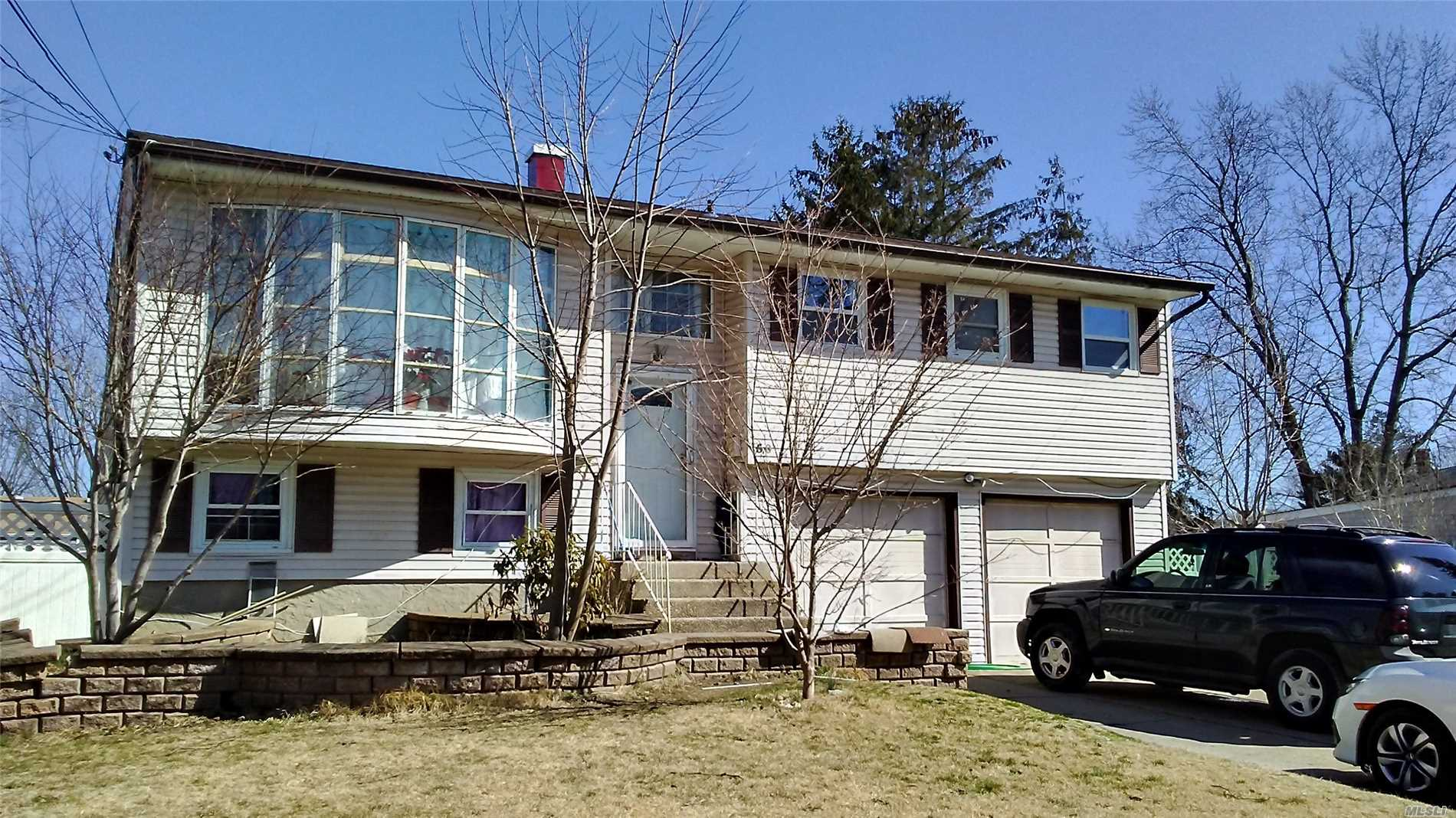 Photo of home for sale at 50 Winston Dr, Brentwood NY