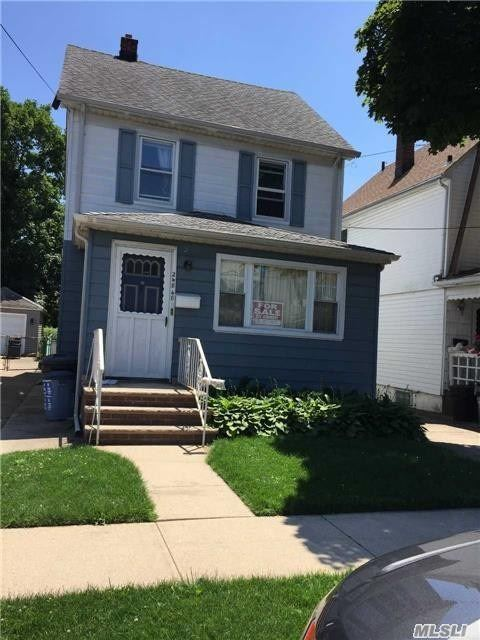Photo of home for sale at 248-48 89th Ave, Bellerose NY