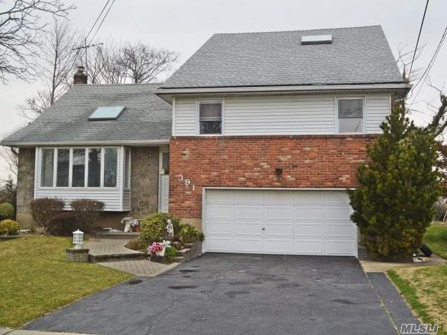 Photo of home for sale at 391 Links Dr E, Oceanside NY
