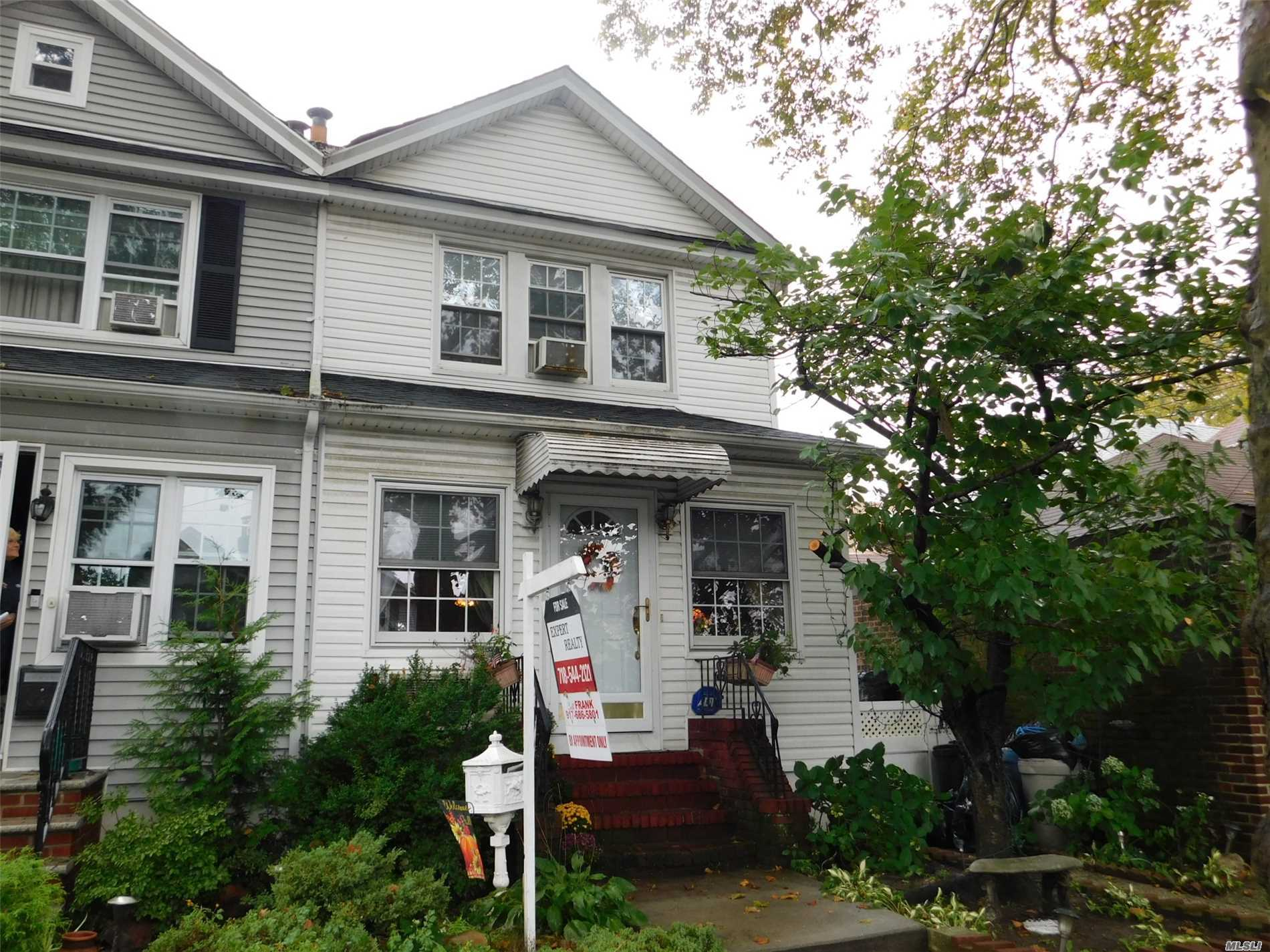 Photo of home for sale at 70-49 Manse St, Forest Hills NY