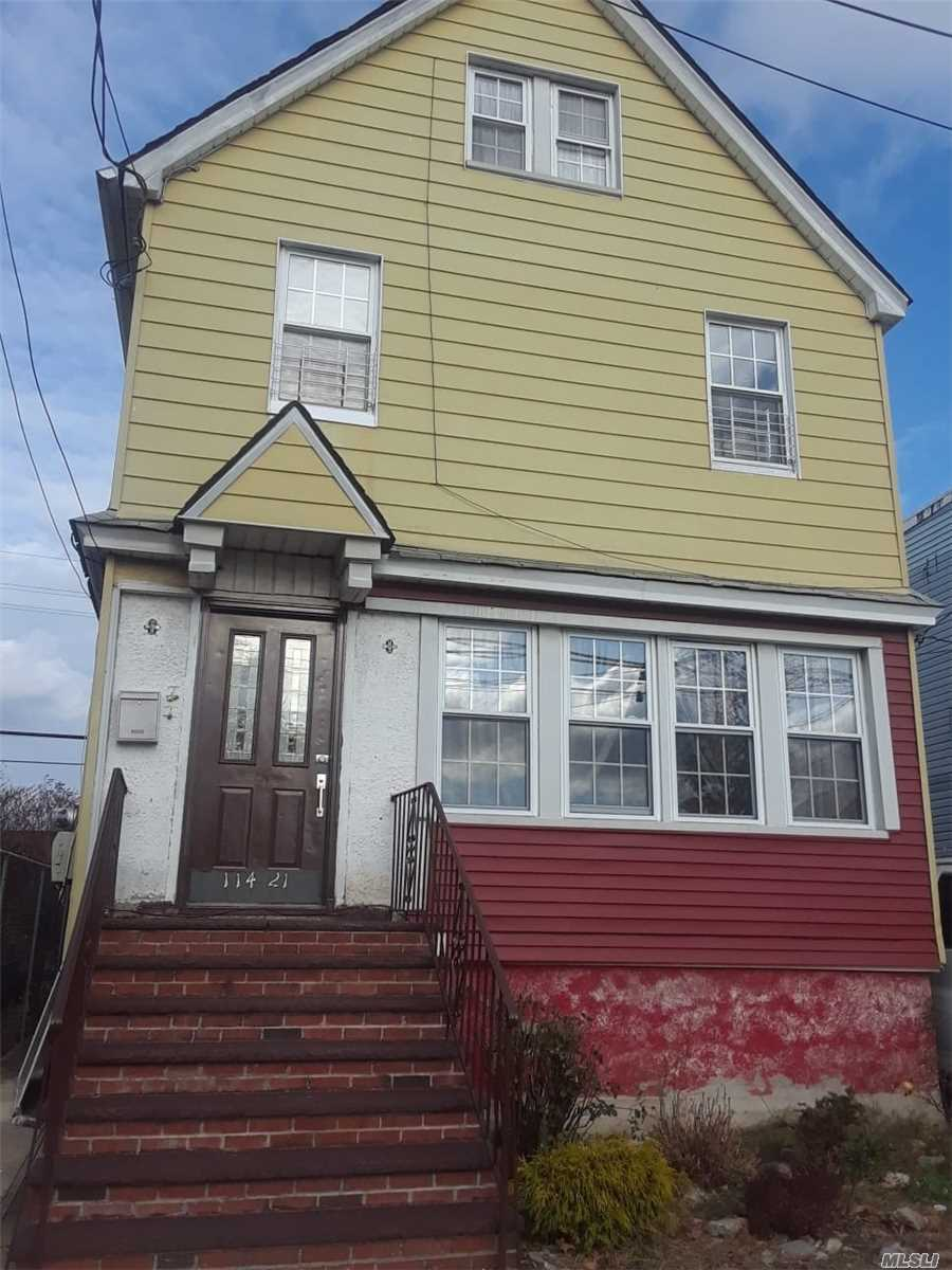 Photo of home for sale at 114-21 Bedell St, Jamaica NY