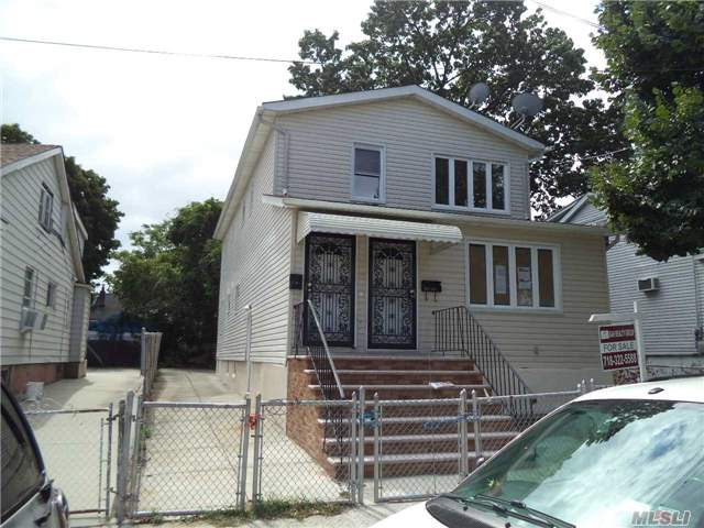 Photo of home for sale at 153-24 119 Rd, Jamaica NY
