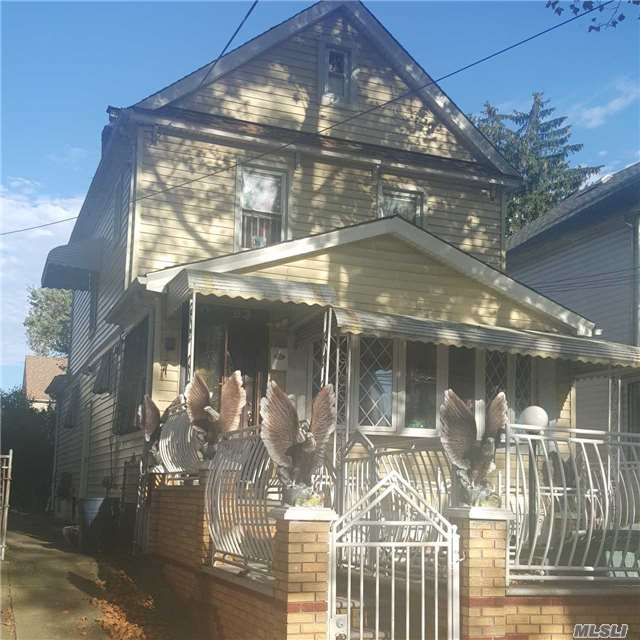 Photo of home for sale at 109-93 202nd St, St. Albans NY