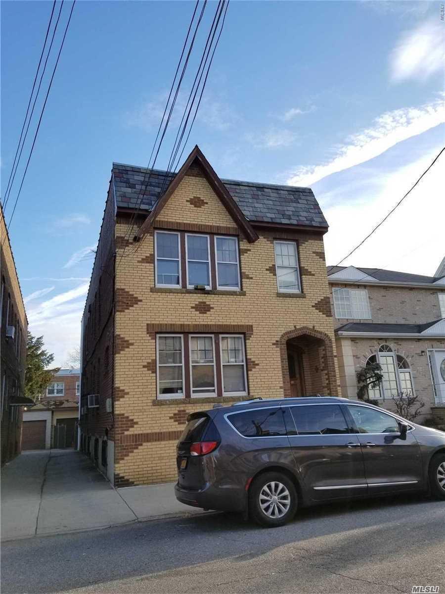 Photo of home for sale at 71-11 72 Pl, Glendale NY