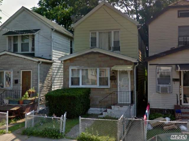 Photo of home for sale at 116-48 143rd St, Jamaica NY