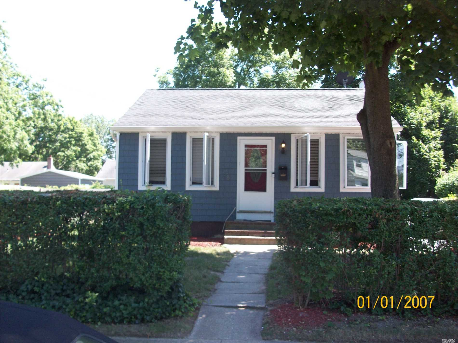 Photo of home for sale at 18 Booker Ave E, Wyandanch NY