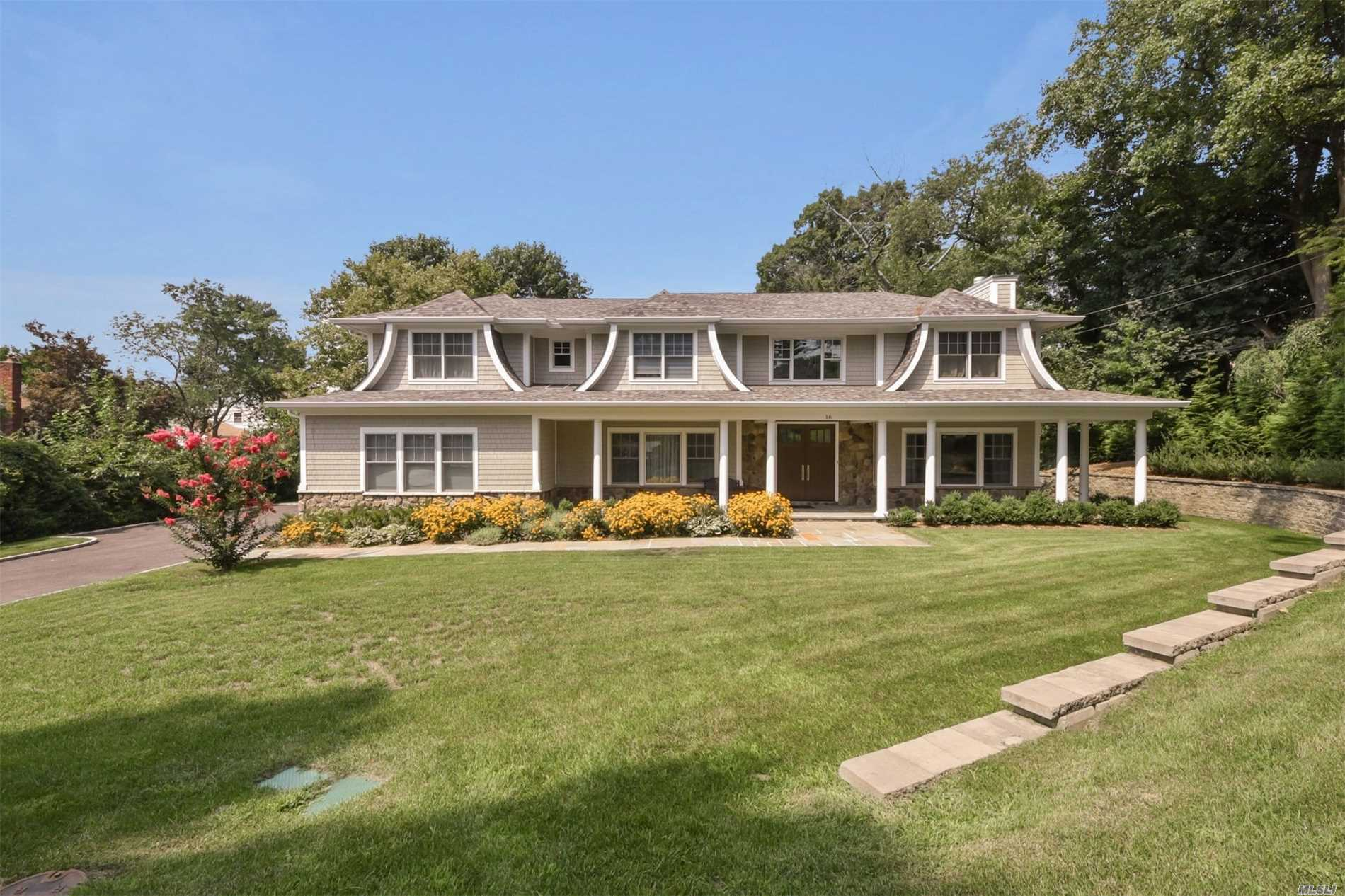 Photo of home for sale at 16 Talley Rd, East Hills NY