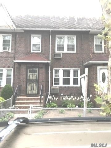Photo of home for sale at 84-39 63 Ave, Middle Village NY