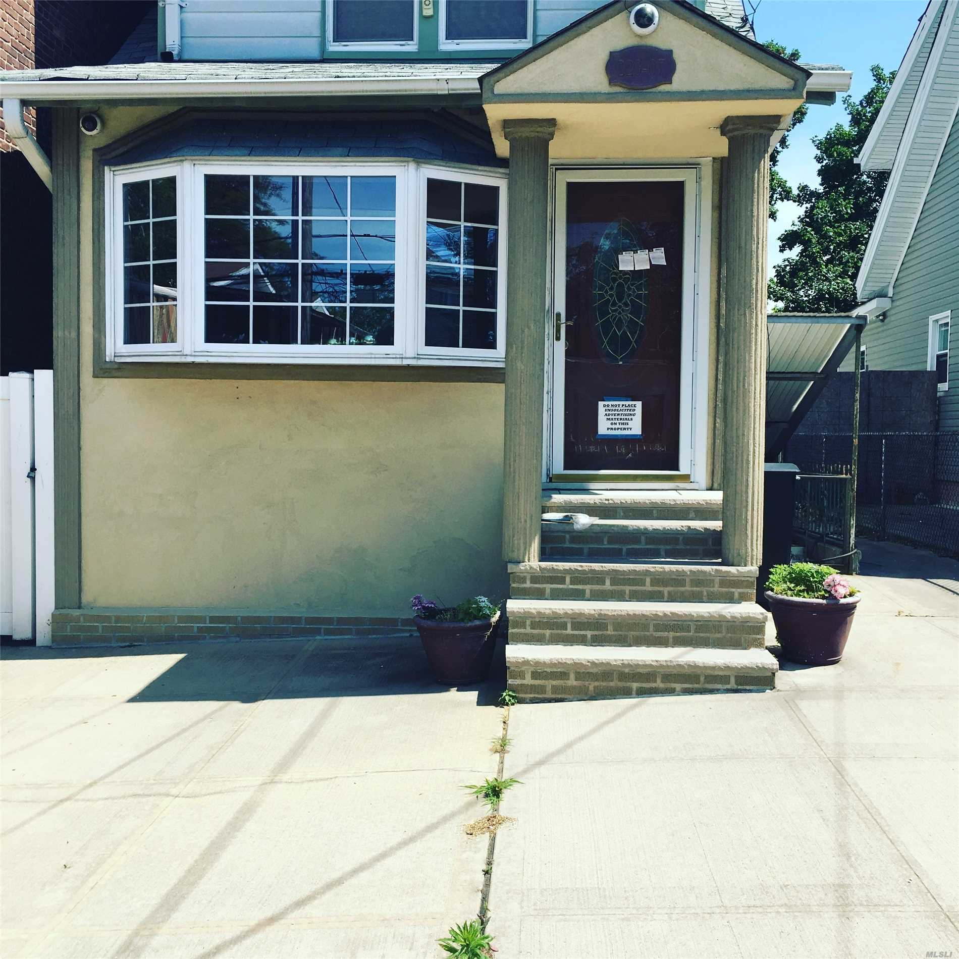 Photo of home for sale at 223-07 135th Ave, Laurelton NY