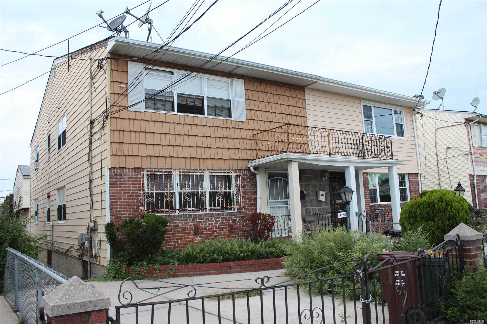 Photo of home for sale at 145-66 226th St, Rosedale NY
