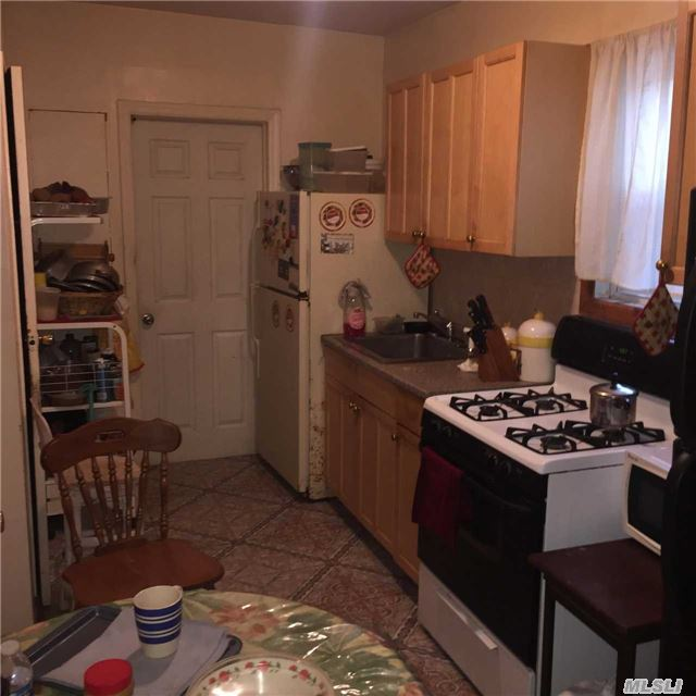 Photo of home for sale at 225-31 107th Ave, Queens Village NY