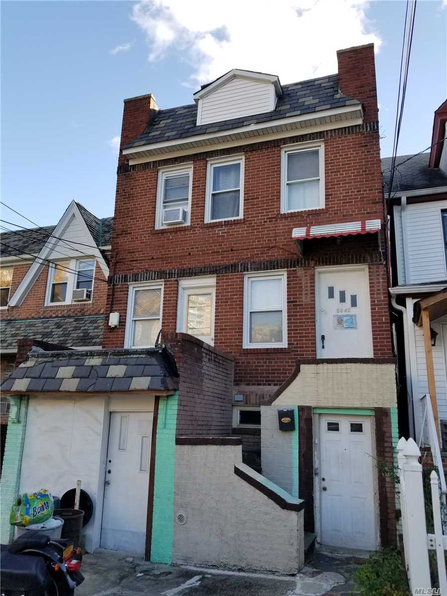 Photo of home for sale at 59-42 48 Ave, Woodside NY