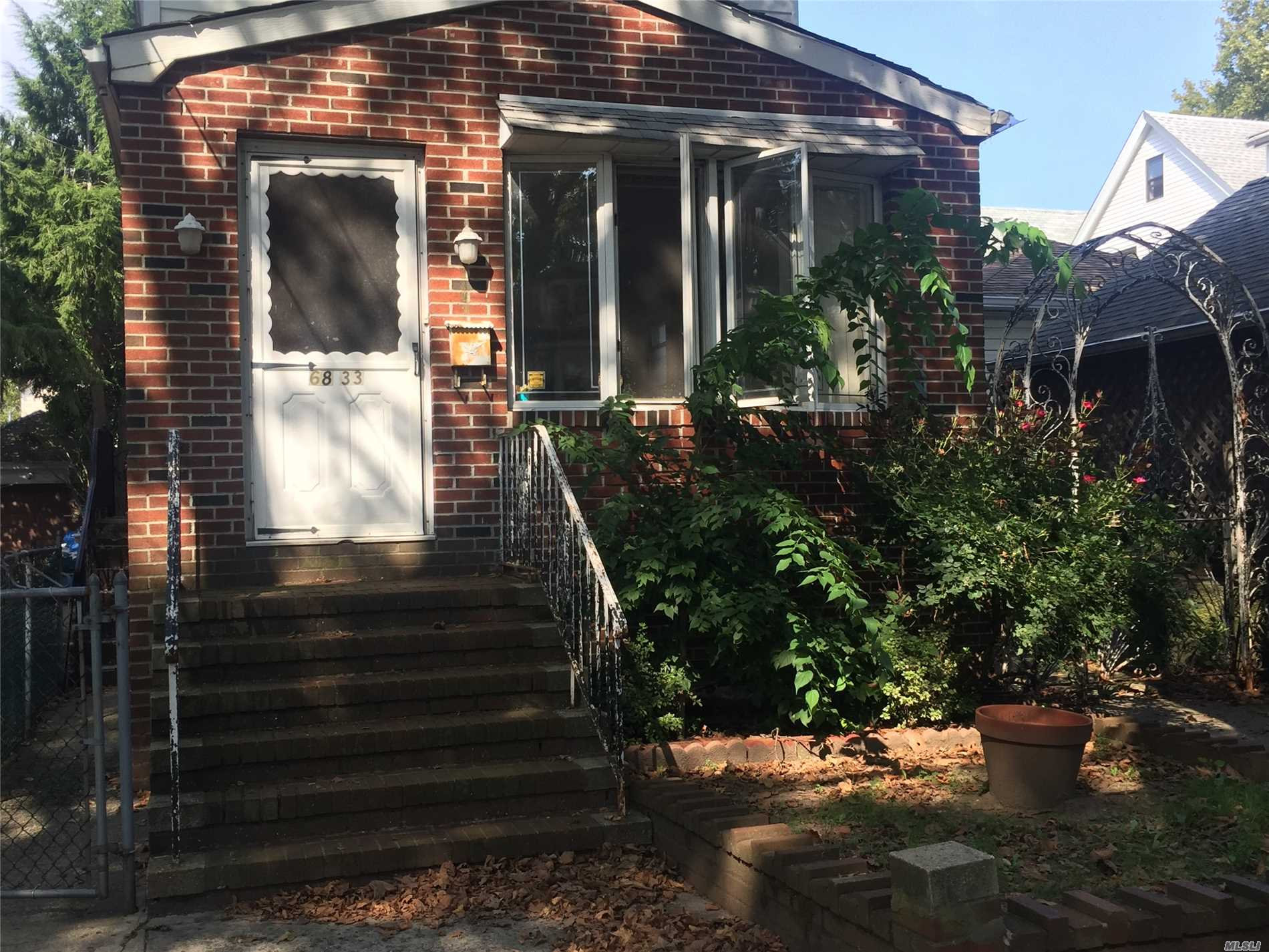 Photo of home for sale at 68-33 Olcott St, Forest Hills NY