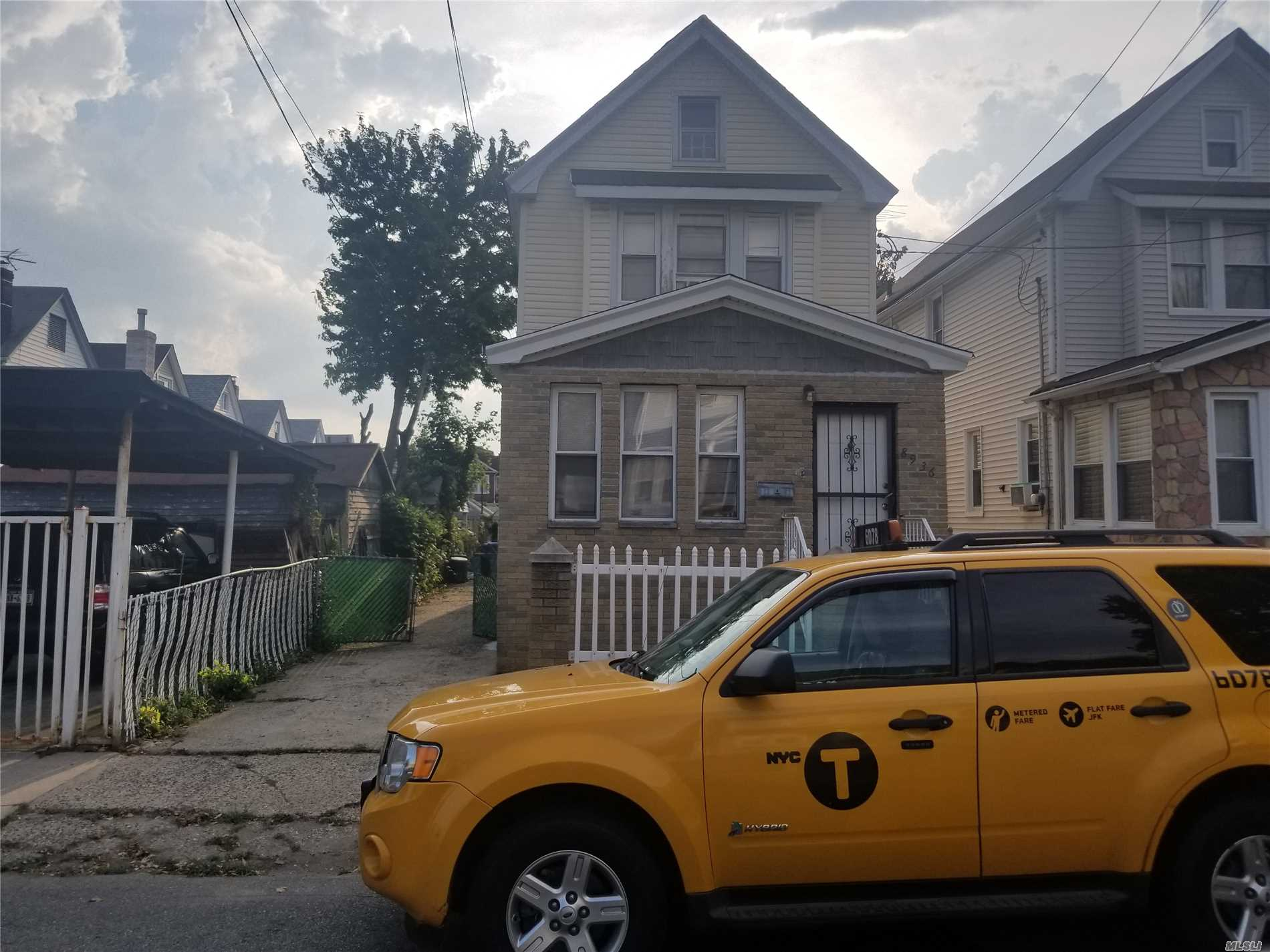 Photo of home for sale at 89-36 184th Pl, Jamaica NY
