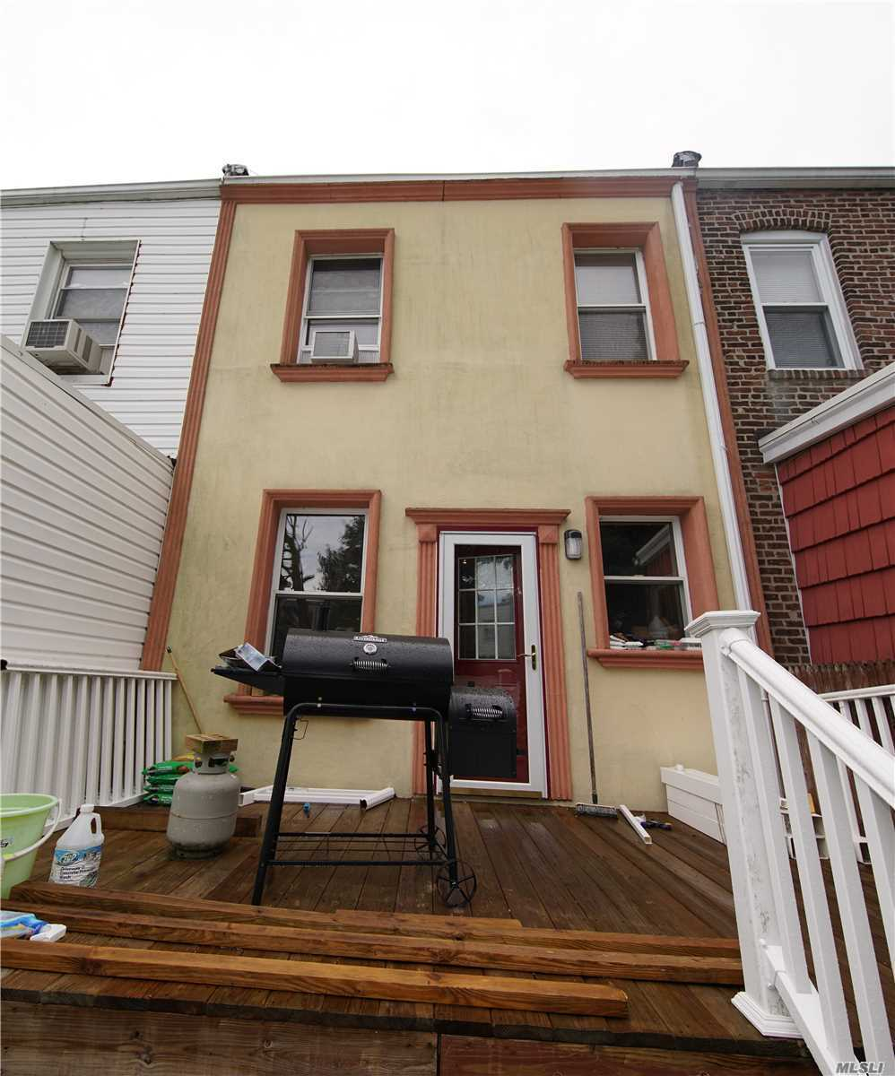 Photo of home for sale at 91-31 85th St, Woodhaven NY