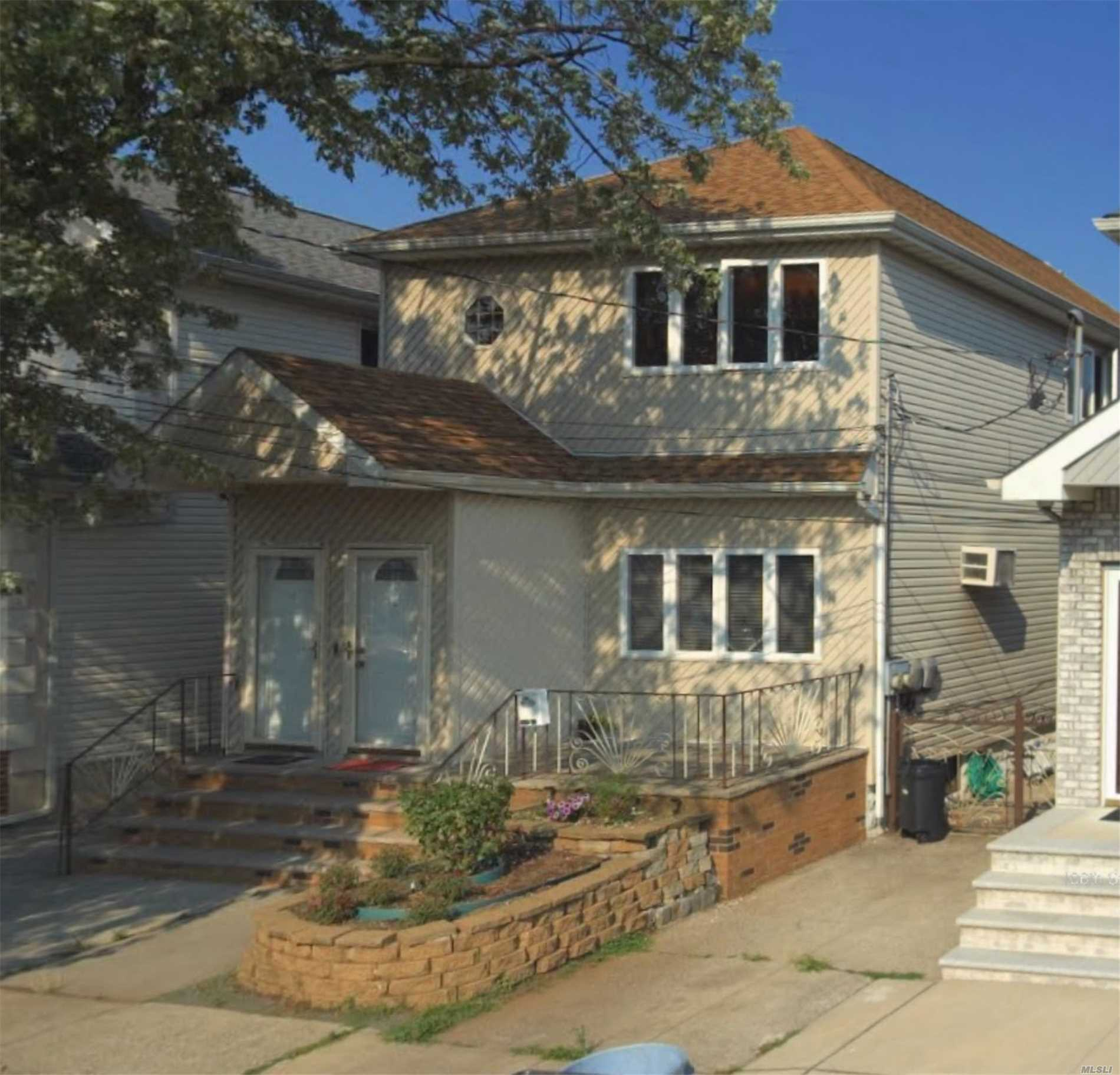 Photo of home for sale at 132-15 106th St, Ozone Park NY