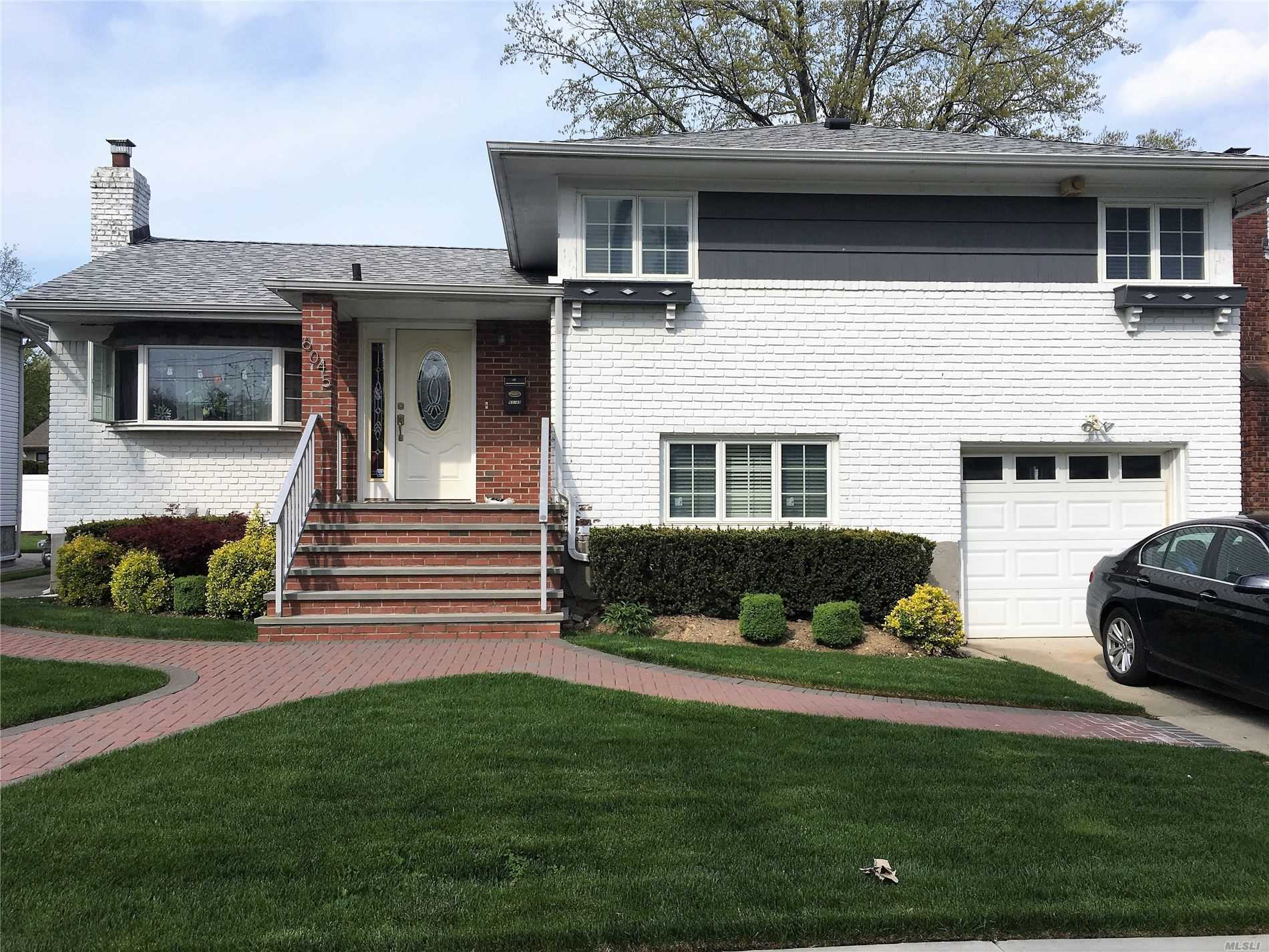 Photo of home for sale at 60-45 Hewlett St, Little Neck NY