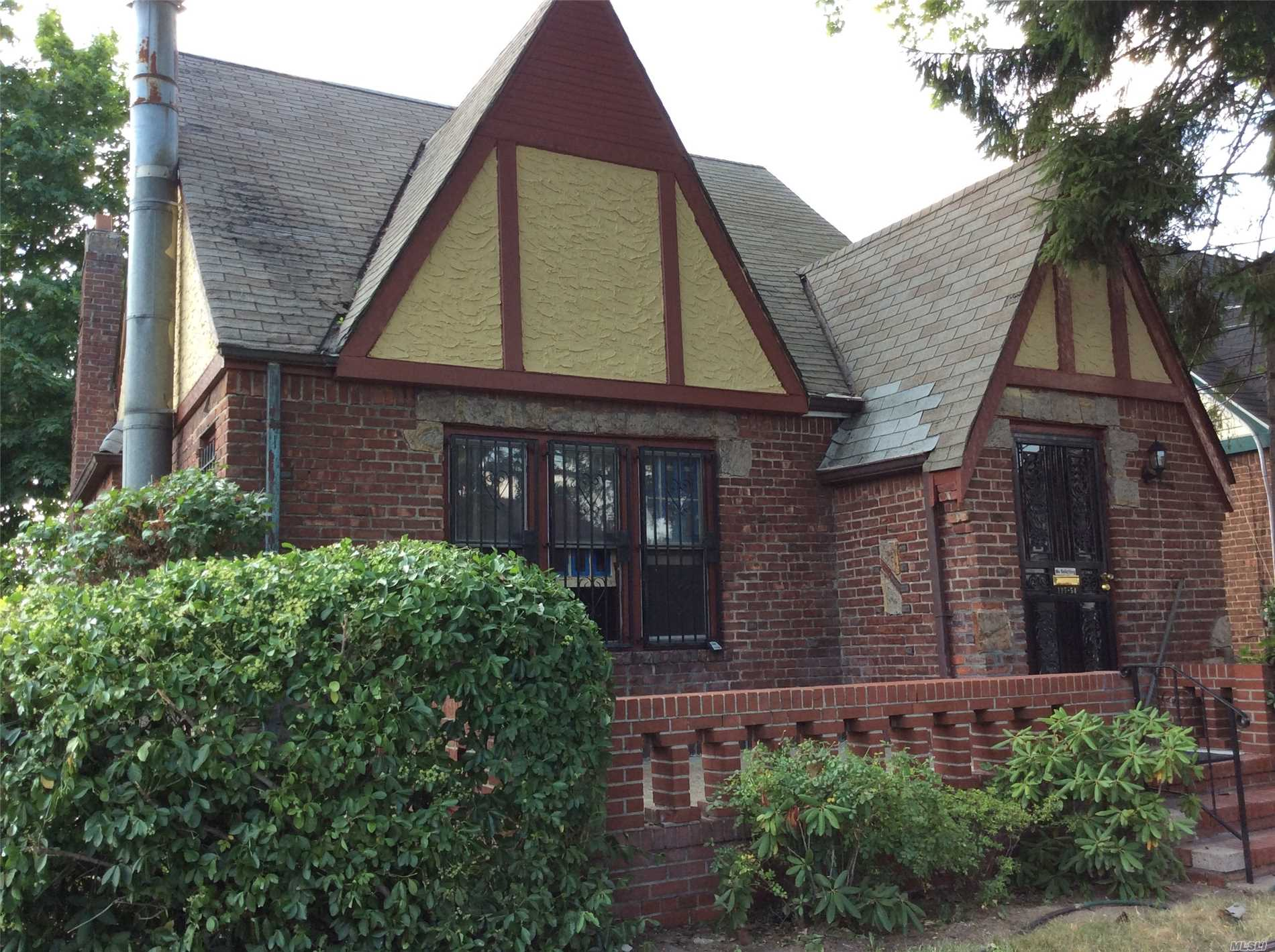 Photo of home for sale at 117-54 219th St, Cambria Heights NY
