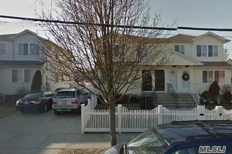 Photo of home for sale at 563 Beach 63rd St, Far Rockaway NY