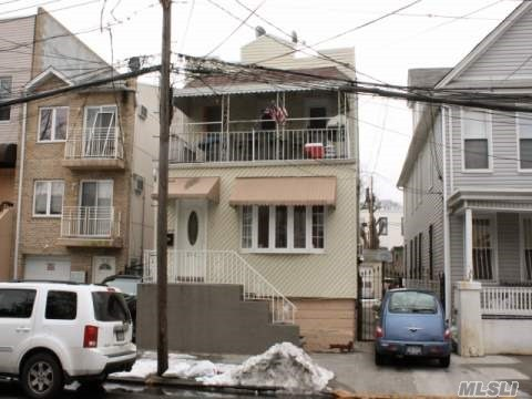 Photo of home for sale at 58-60 78 Ave, Glendale NY