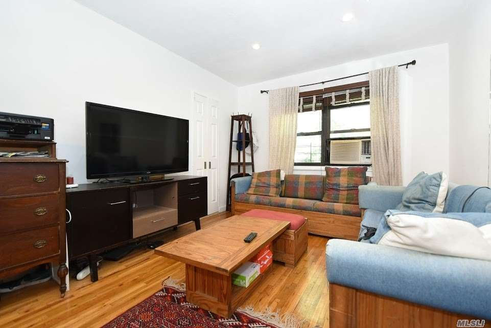 Photo of home for sale at 147-22 72nd Ave, Kew Garden Hills NY