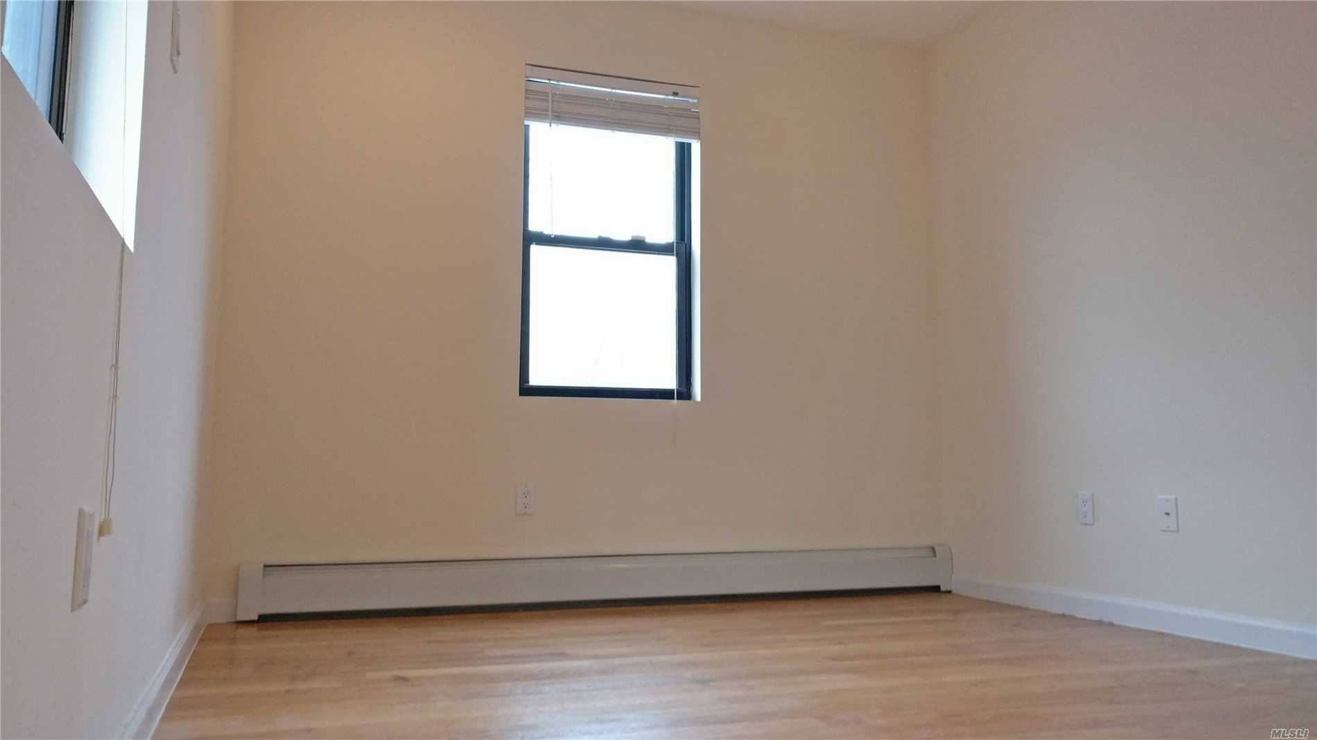 Photo of home for sale at 6118 155th St, Flushing NY