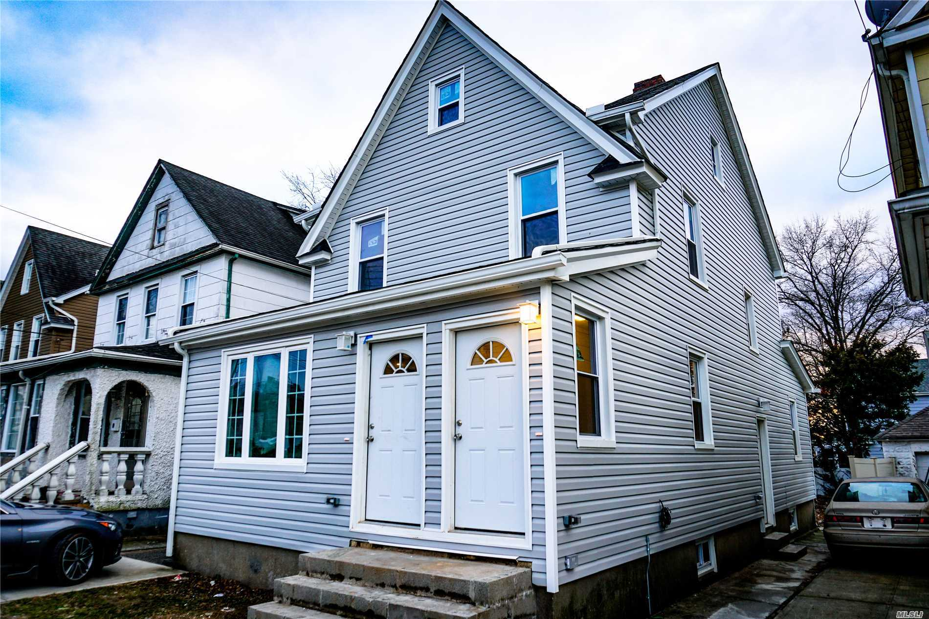 Photo of home for sale at 117-24 200th St, Jamaica NY