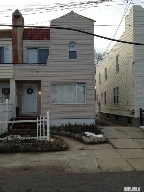 Photo of home for sale at 205-26 110th Ave, Jamaica NY