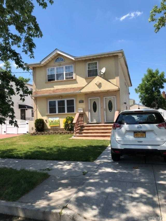 Photo of home for sale at 241-23 148th Ave, Jamaica NY