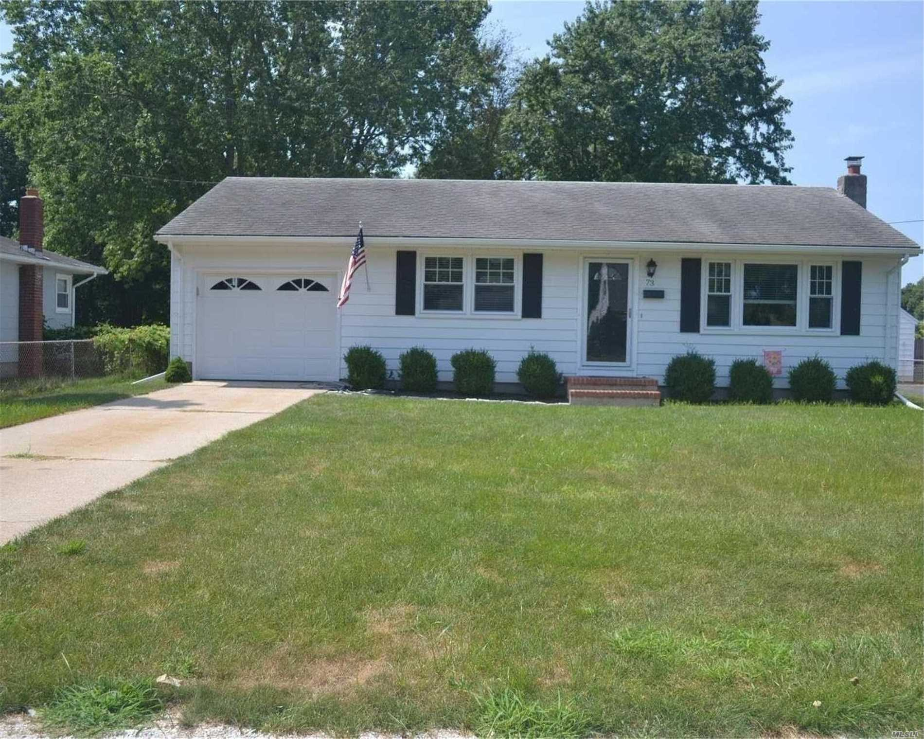 Photo of home for sale at 73 Fairway Ave, Riverhead NY