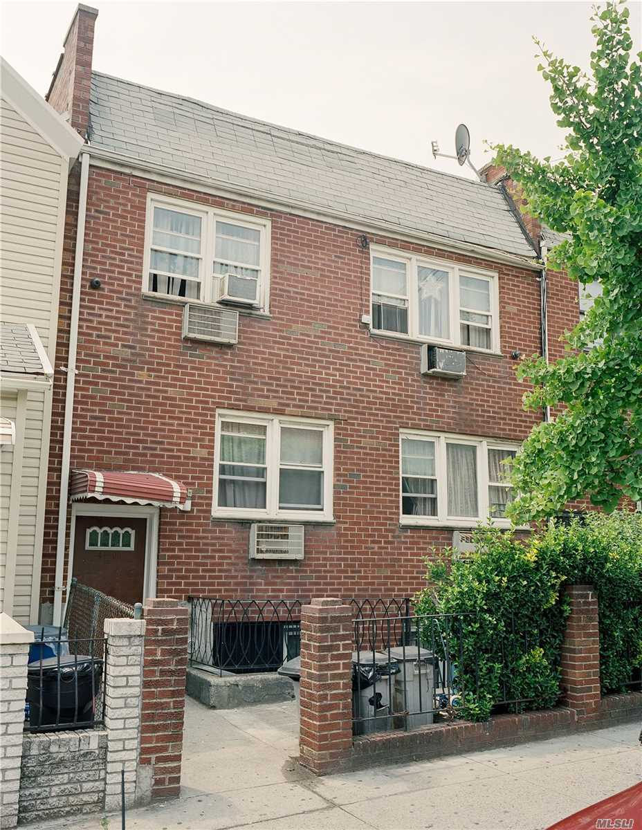 Photo of home for sale at 41-08 111Th St, Corona NY