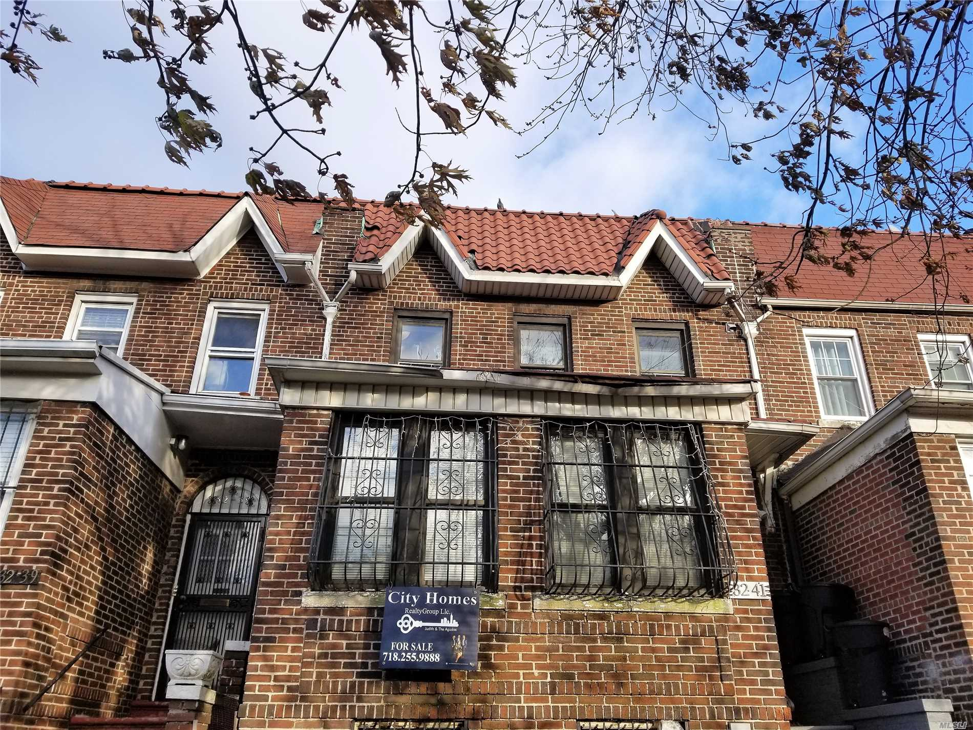 Photo of home for sale at 32-41 84th St, East Elmhurst NY