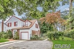 Photo of home for sale at 399 Merrick Rd W, Freeport NY