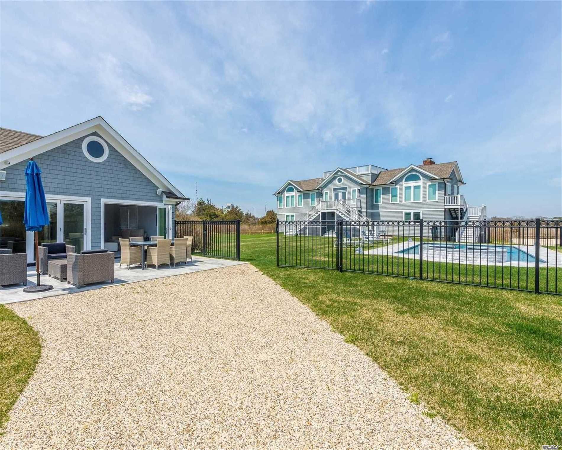 Photo of home for sale at 115 Dune Rd, Quogue NY