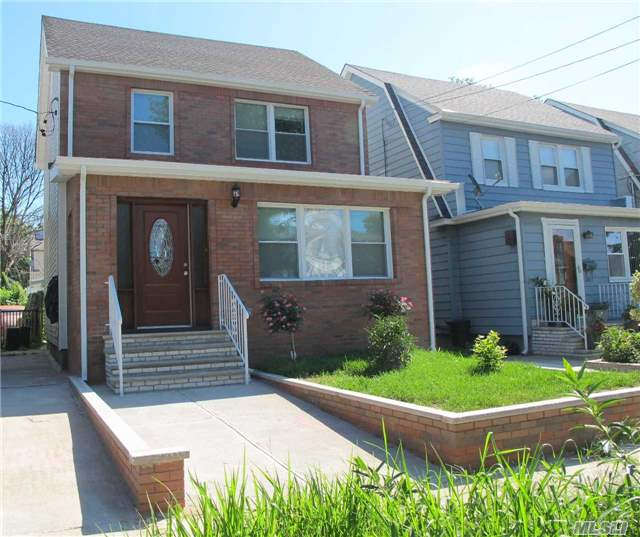 Photo of home for sale at 89-11 Hollis Court Blvd, Queens Village N NY