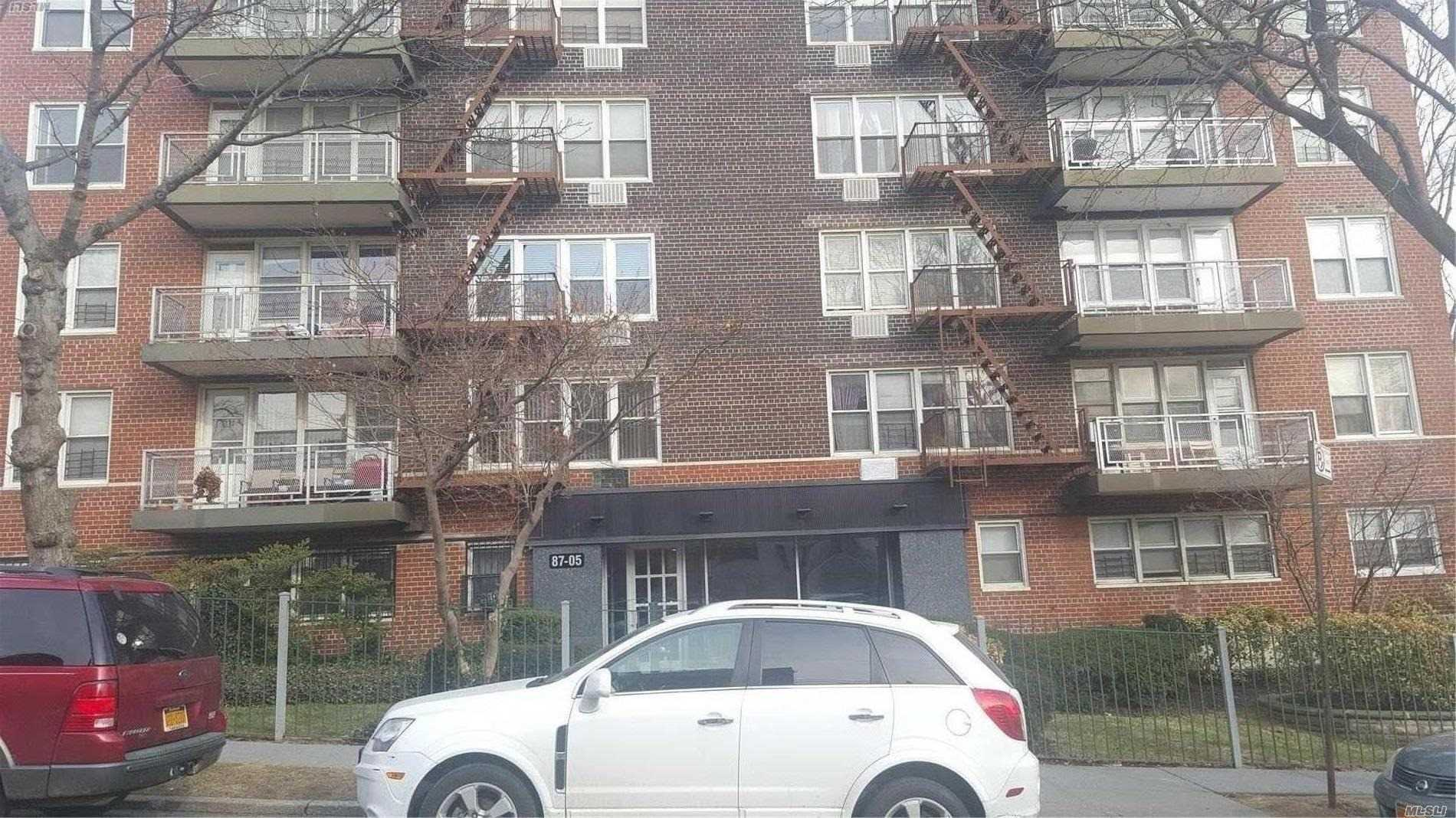Photo of home for sale at 87-05 166th St, Jamaica NY