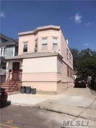 Photo of home for sale at 12-15 120 St, College Point NY