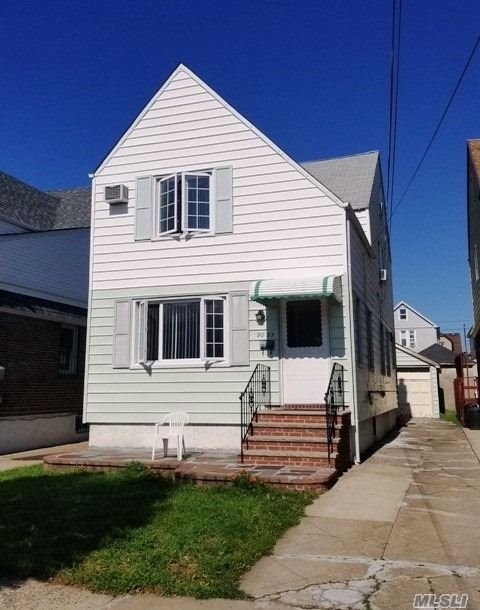 Photo of home for sale at 90-35 210th Pl, Queens Village NY