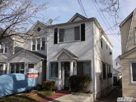Photo of home for sale at 114-23 120th Street, South Ozone Park NY