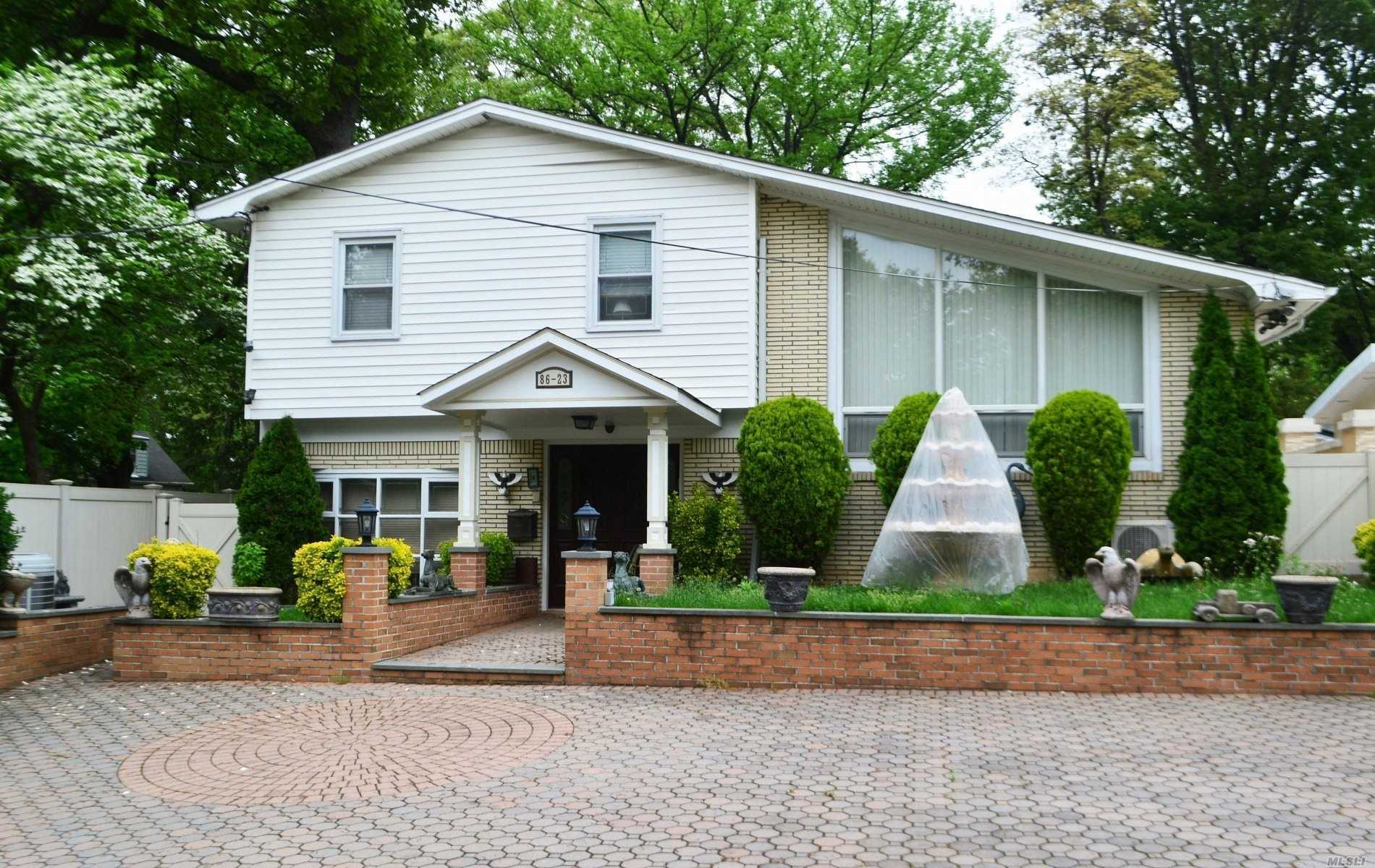 Photo of home for sale at 86-23 Sancho St, Holliswood NY