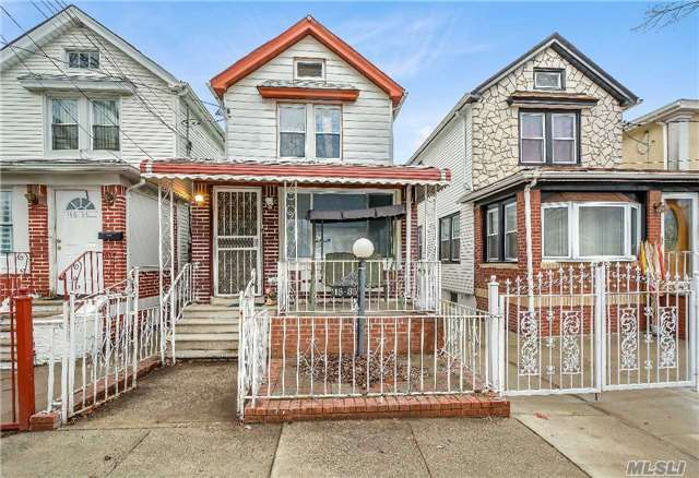 Photo of home for sale at 116-35 134 St, South Ozone Park NY